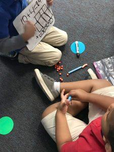 Kindergartners peer teaching